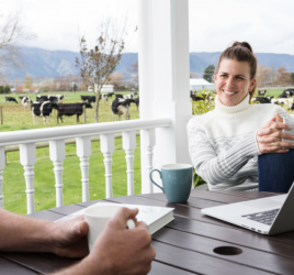 Farmers talking with laptop
